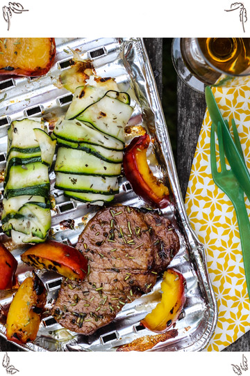 Pork Loin Steaks with grilled nectarins and sheep cheese zucchini rolls
